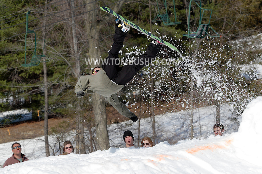 Warwick, New York - A snowboarder twists through the air in front of the judges after flying off the jump during the Big Air competition at the annual Spring Rally at Mount Peter Ski and Ride on March 21, 2010.