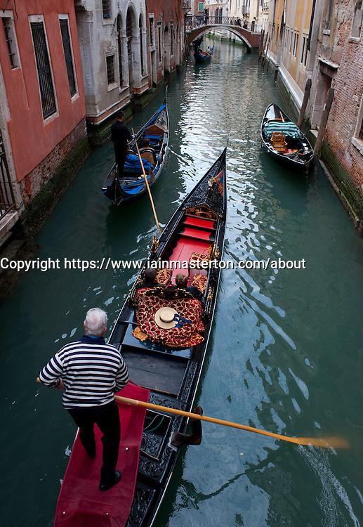 Gondolas on small canal in Venice Italy