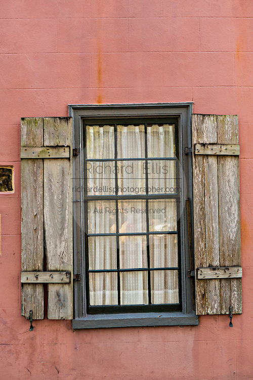 Window in an old home in the historic district in St. Augustine, Florida. St Augustine is the oldest city in America.