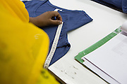 Clothes being measured and checked inside an Epyllion Group factory in Bangladesh.