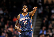 Feb. 4, 2012; Phoenix, AZ, USA; Charlotte Bobcats forward Tyrus Thomas (12) reacts on the court against the Phoenix Suns during the first half at the US Airways Center.  The Suns defeated the Bobcats 95 - 89. Mandatory Credit: Jennifer Stewart-US PRESSWIRE.