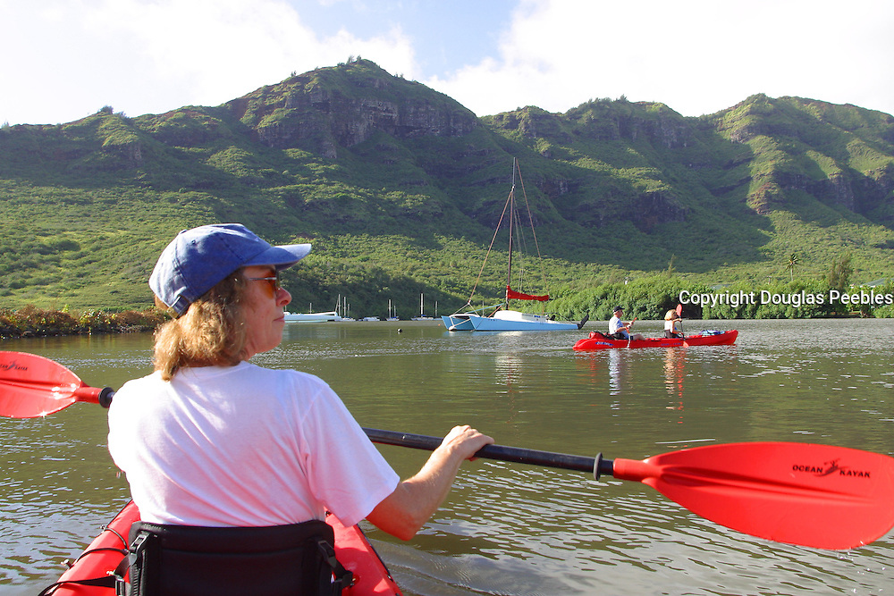 Kayaking Huleia River, Kauai, Hawaii, (editorial use only, no model release)<br />