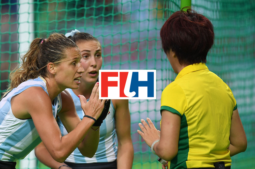 Argentina's Delfina Merino (L) gestures to the referee during the women's field hockey Britain vs Argentina match of the Rio 2016 Olympics Games at the Olympic Hockey Centre in Rio de Janeiro on August, 10 2016. / AFP / MANAN VATSYAYANA        (Photo credit should read MANAN VATSYAYANA/AFP/Getty Images)