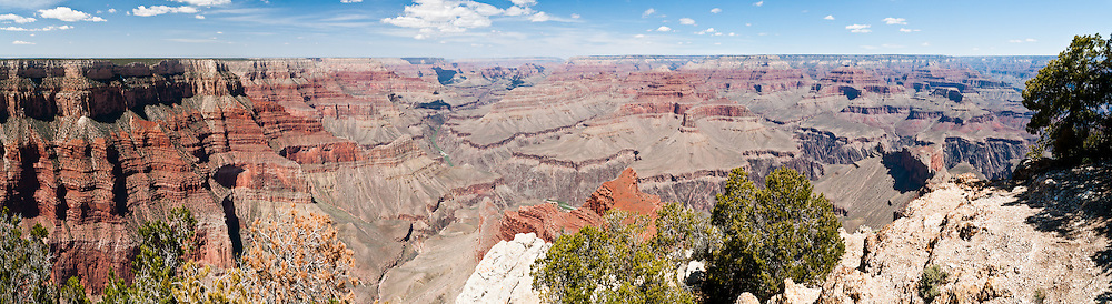 Mojave Point, South Rim of Grand Canyon National Park, Arizona, USA. Grand Canyon began forming at least 5 to 17 million years ago and now exposes a geologic wonder, a column of well-defined rock layers dating back nearly two billion years at the base. While the Colorado Plateau was uplifted by tectonic forces, the Colorado River and tributaries carved Grand Canyon over a mile deep (6000 feet / 1800 meters), 277 miles (446 km) long and up to 18 miles (29 km) wide. (Panorama stitched from 6 photos.)