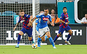 FC Barcelona forward Caries Perez (27) and defender Nikola Maksimovic (19) fight for possession of the ball during a La Liga-Serie A Cup soccer match, Wednesday, Aug. 7, 2019, in Miami Gardens, Fla. FC Barcelona beat Napoli 2-1 (Kim Hukari/Image of Sport)