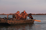 Rowing a duck boat in early morning light during a Manitoba waterfowl hunt.