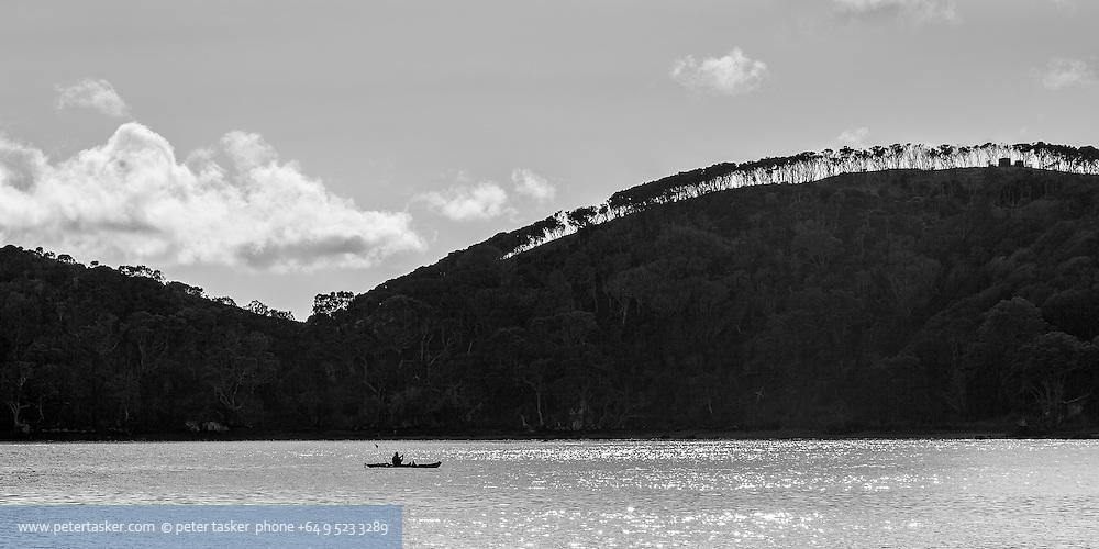 Kayak fishing in the entrance to Kawau Bay.