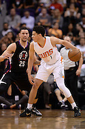 PHOENIX, AZ - APRIL 13:  Devin Booker #1 of the Phoenix Suns handles the ball against Austin Rivers #25 of the Los Angeles Clippers in the first half of the NBA game at Talking Stick Resort Arena on April 13, 2016 in Phoenix, Arizona.  The Suns won 114 - 105. NOTE TO USER: User expressly acknowledges and agrees that, by downloading and or using this photograph, User is consenting to the terms and conditions of the Getty Images License Agreement. (Photo by Jennifer Stewart/Getty Images)