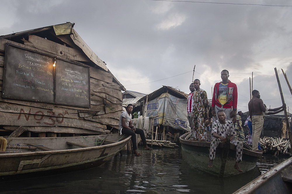 Fans arrive by boat for the Nigeria vs Argentina match during the 2014 FIFA World Cup in the slum of Makoko.