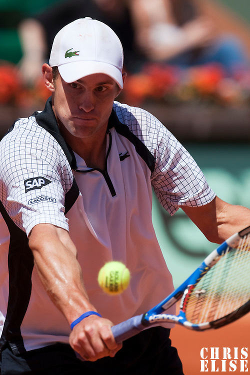 30 May 2009: Andy Roddick of USA hits a backhand during the Men's Singles third round match on day seven of the French Open at Roland Garros in Paris, France.