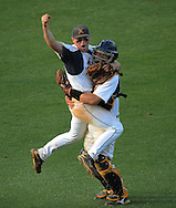 110529  Atlanta -   Marist pitcher David Bourbonnais  jumps in the arms of catcher Charlie Mathes after winning the Class AAAA baseball championship against Whitewater at Marist on Saturday,May 28,2011.Johnny Crawford  jcrawford@ajc.com