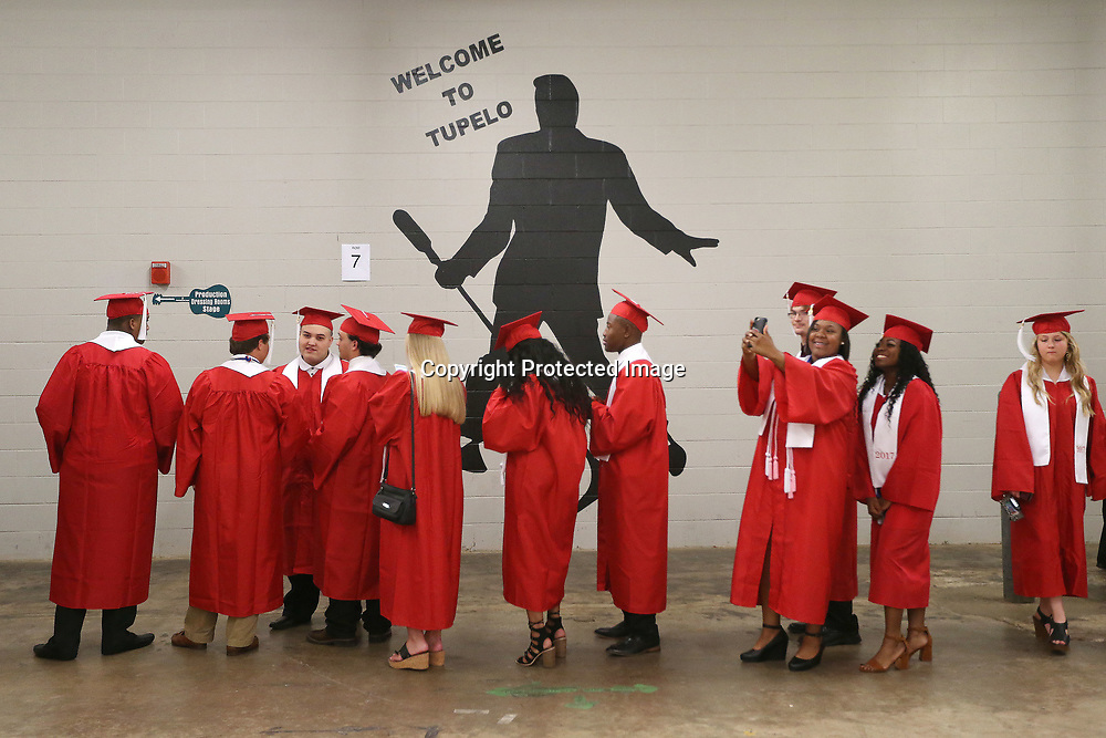 Shannon High School seniors line up before the start of Shannon's graduation ceremony Saturday evening at the BancorpSouth Arena.