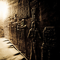 Wall reliefs of priests in the tunnels at the Temple of Dendera, Egypt, circa 200 BC