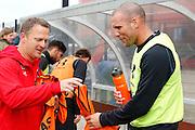 ALKMAAR - 20-10-2015, training Ron Vlaar, AFAS Stadion, AZ trainer John van den Brom geeft een oranje hesje zodat hij zich nog een beetje bij Oranje thuis voelt.