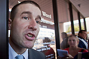 """Sept. 6, 2009 -- TEMPE, AZ: REV. STEVEN ANDERSON argues with reporters in front of his church, the Faithful Word Baptist Church, in Tempe, AZ, Sunday. Anderson, the minister at the Faithful Word Baptist Church, an independent fundamentalist Baptist church, in Tempe has repeatedly said he hoped US President Barack Obama would die from a brain tumor and Sunday, Sept. 6, reiterated that he """"hates"""" President Obama. More than 200 people from a variety of liberal and progressive churches in the Phoenix area picketed Anderson's church Sunday morning, outnumbering his small congregation of about 50.  Photo by Jack Kurtz"""