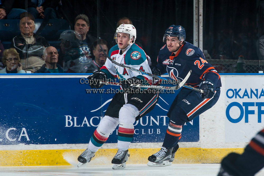 KELOWNA, CANADA - MARCH 31: Luc Smith #24 of the Kamloops Blazers stick checks Gordie Ballhorn #4 of the Kelowna Rockets on March 31, 2017 at Prospera Place in Kelowna, British Columbia, Canada.  (Photo by Marissa Baecker/Shoot the Breeze)  *** Local Caption ***
