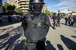 November 10, 2018 - Barcelona, Catalonia, Spain - A Mosso d'Esquadra, Catalan police, is seen blocking the way against the protesters during the demonstration..Some 500 people have gathered to protest the demonstration of pride of the Spanish police in Barcelona organized by the Spanish Police Union and which was intended to commemorate the police repression of the October 1 referendum. (Credit Image: © Paco Freire/SOPA Images via ZUMA Wire)