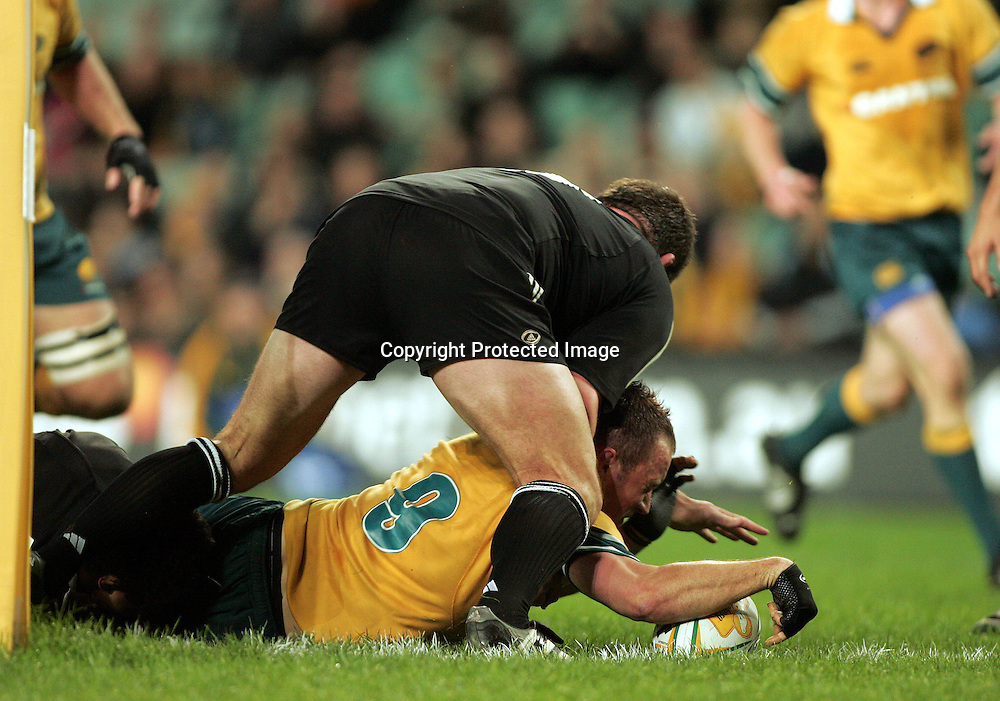 Matt Henjak not awarded this try with pressure from Stephen Bates during the  Match between the Australia A v Junior All Blacks at Aussie Stadium, Sydney on 1 July 2005. The Junior Blacks won the game 34-29. Photo: Paul Seiser ©Seiser Photography/PHOTOSPORT