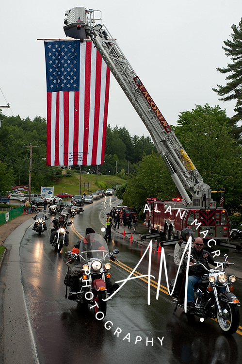 Despite the rain, a large group of motorcyclists depart the Naswa Resort in Laconia in the annual Makris Charity run on Saturday, June 12, 2010.  (Alan MacRae/for the Citizen)