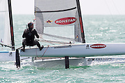 Chris Nicholson (AUS1003) rounds the top mark in race three of the A Class World championships regatta being sailed at Takapuna in Auckland. 12/2/2014
