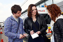 UK ENGLAND LONDON 15APR10 - Stranded airline passengers Daniel Maehlich (23, L) from Vienna and Nicole Ranseder (18, R) from lower Austria are interviewed  by BILD reporter Monika Kennedy (C) at Heathrow's Terminal 1 awaiting further news of air traffic. Today the UK's airspace was totally closed due to high altitude ash clouds after a volcanic eruption in Iceland...jre/Photo by Jiri Rezac..© Jiri Rezac 2010