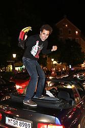 23.06.2010, Leopoldstrasse Schwabing, Muenchen, GER, FIFA Worldcup, Fanfeier nach Ghana vs Deutschland,  im Bild Fan auf autokofferaum, EXPA Pictures © 2010, PhotoCredit: EXPA/ nph/  Straubmeier / SPORTIDA PHOTO AGENCY