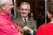 Jim Tressel shares a laugh before his talk at the Ohio University College of Business Schey Sales Centre Symposium on April 14, 2015.  Photo by Ohio University  /  Rob Hardin