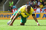 Picture by Paul Chesterton/Focus Images Ltd.  07904 640267.11/9/11.James Vaughan takes an elbow to the face and has to have treatment during the Barclays Premier League match at Carrow Road stadium, Norwich.