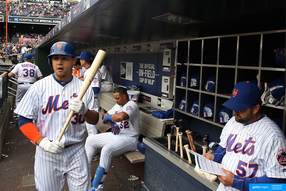 NEW YORK, NEW YORK - May 21:  Michael Conforto #30 of the New York Mets heads out of the dugout to bat as Yoenis Cespedes #52 of the New York Mets prepares to bat  during the Milwaukee Brewers Vs New York Mets regular season MLB game at Citi Field on May 21, 2016 in New York City. (Photo by Tim Clayton/Corbis via Getty Images)
