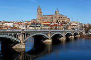 """General view of Enrique Estevan Bridge across the River Tormes, Salamanca, Spain, pictured on December 18, 2010 in the afternoon. The Cathedral is visible in the background. Salamanca, an important Spanish University city, is known as La Ciudad Dorada (""""The golden city"""") because of the unique golden colour of its Renaissance sandstone buildings. Founded in 1218 its University is still one of the most important in Spain. Around it the Old Town is a UNESCO World Heritage Site. Picture by Manuel Cohen"""