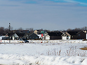 """26 FEBRUARY 2020 - FARMINGTON, MINNESOTA: Suburban development in Farmington, MN, about 30 minutes south of the Twin Cities. Farmington, with a population of 21,000, is a farming community that has become a Twin Cities suburb, the population has doubled since the 2000 census. The city lost its only grocery store, a Family Fresh Market, in December, 2019. The closing turned the town into a """"food desert."""" The USDA defines food deserts as having at least 33% or 500 people of a census tract's population in an urban area living 1 mile from a large grocery store or supermarket. Grocery chains Hy-Vee and Aldi both own land in Farmington but they have not said when they plan to build or open stores in the town.      PHOTO BY JACK KURTZ"""