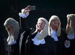 © Licensed to London News Pictures. 03/10/2016. London, UK. A judge takes a phone photo as he walks with others to Parliament after attending a Service at Westminster Abbey. The Service heralds the start of the legal year in the United Kingdom  - the fourth term of the legal year, known as Michaelmas term. Photo credit: Peter Macdiarmid/LNP