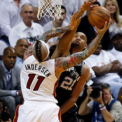 Jun 6, 2013; Miami, FL, USA; San Antonio Spurs power forward Tim Duncan (21) blocks the shot of Miami Heat power forward Chris Andersen (11) in the second quarter during game one of the 2013 NBA Finals at the American Airlines Arena. Mandatory Credit: Derick E. Hingle-USA TODAY Sports