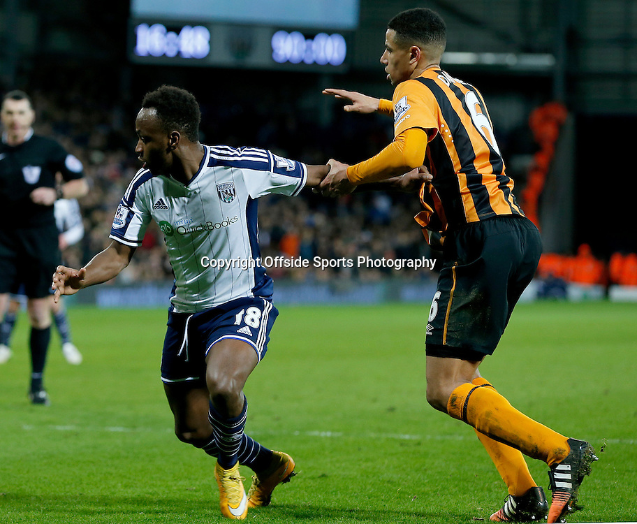 10th January 2015 - Barclays Premier League - West Bromwich Albion v Hull City - Curtis Davis of Hull City pulls back Saido Berahino of West Bromwich Albion - Photo: Paul Roberts / Offside.