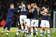Picture by Paul Chesterton/Focus Images Ltd +44 7904 640267.26/01/2013.The Luton players celebrate victory at the end of The FA Cup 4th Round match at Carrow Road, Norwich.