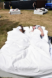 Life art installation 'Everything by my Side' at Latitude Festival 2016, Henham Park, Suffolk, UK. Slip into bed with a stranger for a personal encounter in the middle of the busy festival