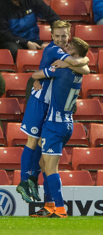 Andy Kellett of Wigan Athletic (left) is congratulated by team-mate Michael Jacobs after Kellett put their team 1-0 up during the Sky Bet League 1 match at Oakwell, Barnsley<br /> Picture by Russell Hart/Focus Images Ltd 07791 688 420<br /> 19/12/2015