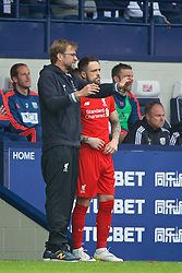 WEST BROMWICH, ENGLAND - Sunday, May 15, 2016: Liverpool's manager Jürgen Klopp prepares to bring on substitute Danny Ings against West Bromwich Albion during the final Premier League match of the season at the Hawthorns. (Pic by David Rawcliffe/Propaganda)