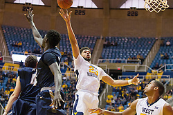 Nov 20, 2016; Morgantown, WV, USA; West Virginia Mountaineers forward Esa Ahmad (23) shoots in the lane during the second half against the New Hampshire Wildcats at WVU Coliseum. Mandatory Credit: Ben Queen-USA TODAY Sports