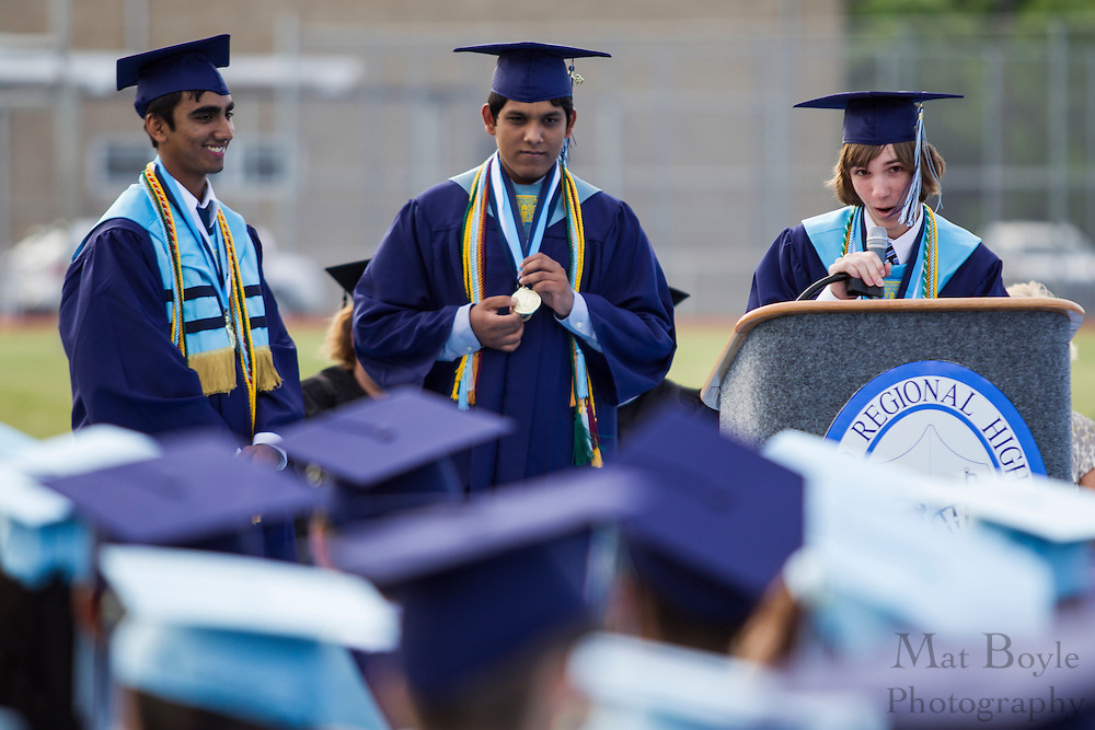 Valedictorian Seth P. Nicosia gives a speech as Sheik Nazmul Hassan (middle) and  Shaiful Alan Kashem listen during Highland Regional High School graduation on Thursdays June 14, 2012 . (photo / Mat Boyle)