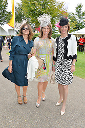 Left to right, SUNETRA ATKINSON, CHICA HERBERT and LADY CAROLYN WARREN at day 3 of the Qatar Glorious Goodwood Festival at Goodwood Racecourse, Chechester, West Sussex on 28th July 2016.