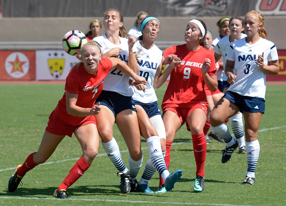 gbs091717m/SPORTS -- UNM's Jessie Hix, 7, Northern Arizona's Emma Robson, 22, Northern Arizona's Adrian Nixt, 19, UNM's Emily Chavez, 9, and Northern Arizona's Riley Porter, 3, line up for an inbound ball during the game at the UNM Soccer Complex on Sunday, September 17, 2017. UNM got the 4-0 victory.(Greg Sorber/Albuquerque Journal)