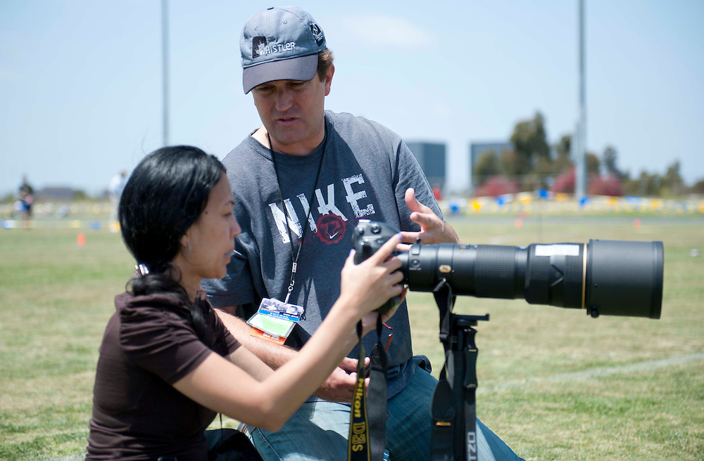 4/29/12 --- SPORTS SHOOTER ACADEMY --- Sports Shooter Academy instructor Wally Skalij offers up advice to workshop participant Elaine Villaflores during a rugby match. Photo by Christy Radecic, Sports Shooter Academy Behind the Scenes with the cast and crew of Sports Shooter Academy.
