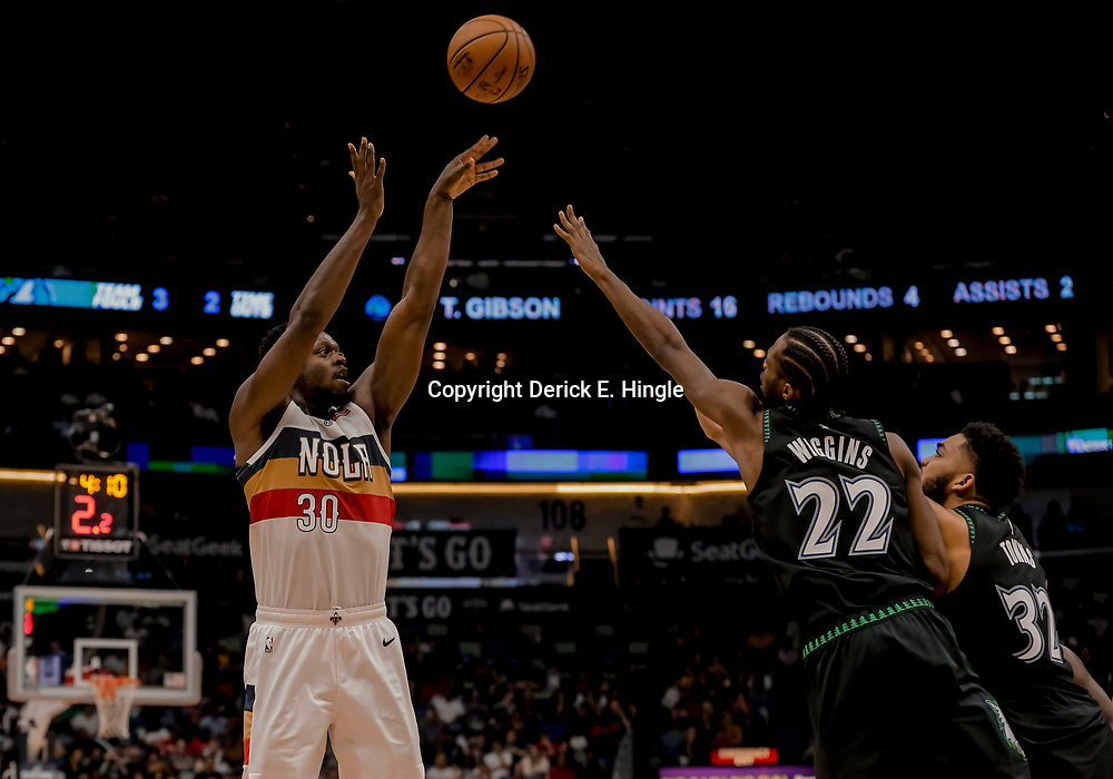Dec 31, 2018; New Orleans, LA, USA; New Orleans Pelicans forward Julius Randle (30) shoots over Minnesota Timberwolves forward Andrew Wiggins (22) and center Karl-Anthony Towns (32) during the second half at the Smoothie King Center. Mandatory Credit: Derick E. Hingle-USA TODAY Sports