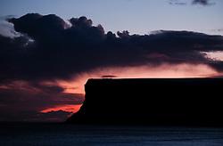 © Licensed to London News Pictures. <br /> 14/01/2015. <br /> <br /> Saltburn, United Kingdom<br /> <br /> A snow cloud sits over Huntcliff at first light in Saltburn, Cleveland as dawn breaks.<br /> <br /> Photo credit : Ian Forsyth/LNP