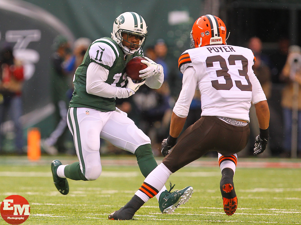 Dec 22, 2013; East Rutherford, NJ, USA; New York Jets wide receiver Jeremy Kerley (11) runs with the ball while Cleveland Browns cornerback Jordan Poyer (33) looks to tackle him during the first half at MetLife Stadium.