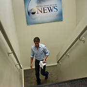 "August 29, 2014 - New York, NY : News Anchor David Muir ascends a staircase in the ABC building on West 66th Street on Friday afternoon. Muir is taking over for Diane Sawyer as anchor of ABC's ""World News Tonight."" CREDIT: Karsten Moran for The New York Times"