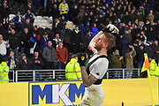 Leeds United defender Pontus Jansson (18) takes shirt of to throw into Leeds Fans during the EFL Sky Bet Championship match between Hull City and Leeds United at the KCOM Stadium, Kingston upon Hull, England on 30 January 2018. Photo by Ian Lyall.