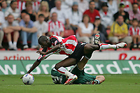 Photo: Lee Earle.<br /> Southampton v Panathinaikos. Pre Season Friendly. 29/07/2006. Southampton's Bradley Wright-Phillips (L) clashes with Anthony Seric.