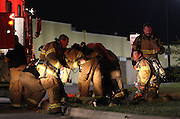 07 September 2010: Fire fighters prepare their equipment after responding to a fire at Atomic Fireworks, near the intersection of Sunshine and West Bypass. Credit: David Welker / TurfImages.com